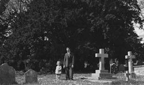 Man and daughter stand in front of the old yew, 1930's