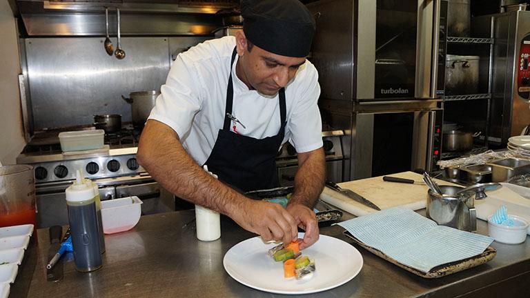 Below: Anuj puts together the mackerel escabeche