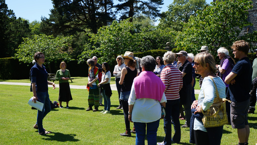 Gardener Katy give volunteers a tour of Dartington's Gardens