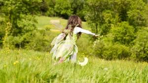 Girl running through field at Dartington. Image:  Rebecca Clelland