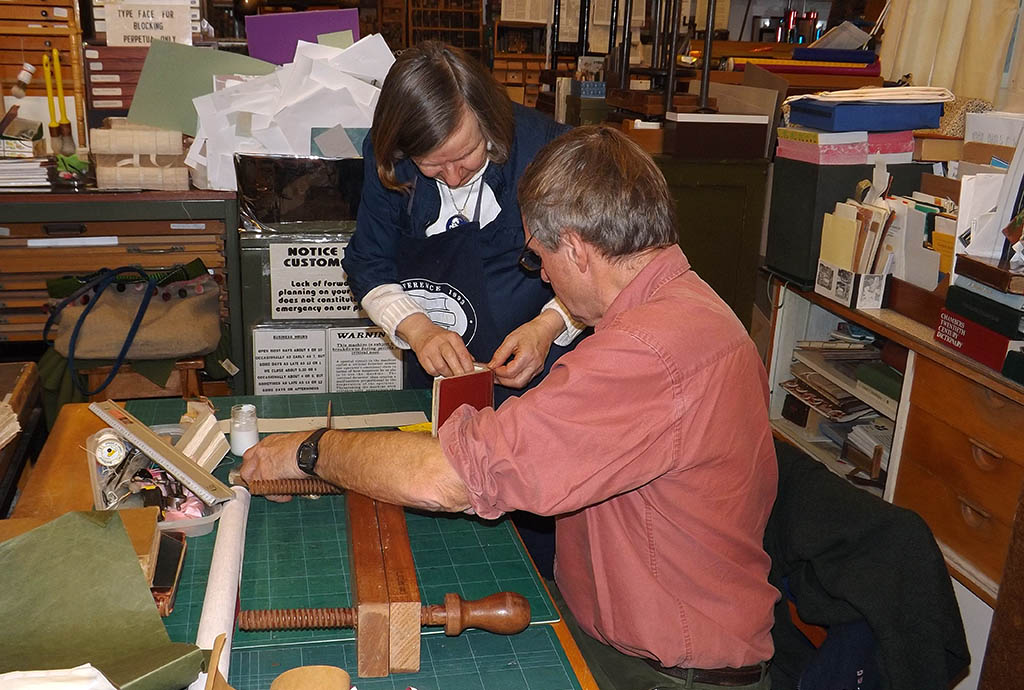 Mary Bartlett and a student in her bookbinding class