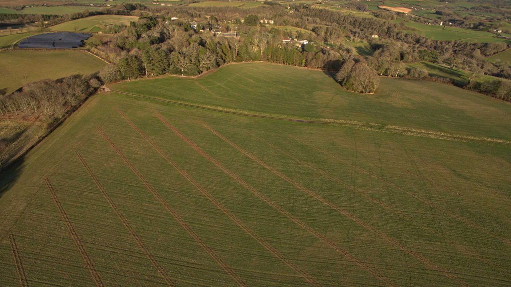 Aeriel shot of Dartinton agroforestry field in context of wider estate credit Gifford Hooper