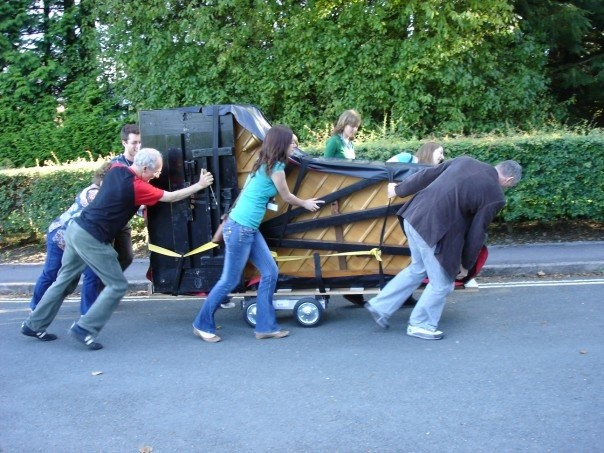 Piano move with volunteers summer school