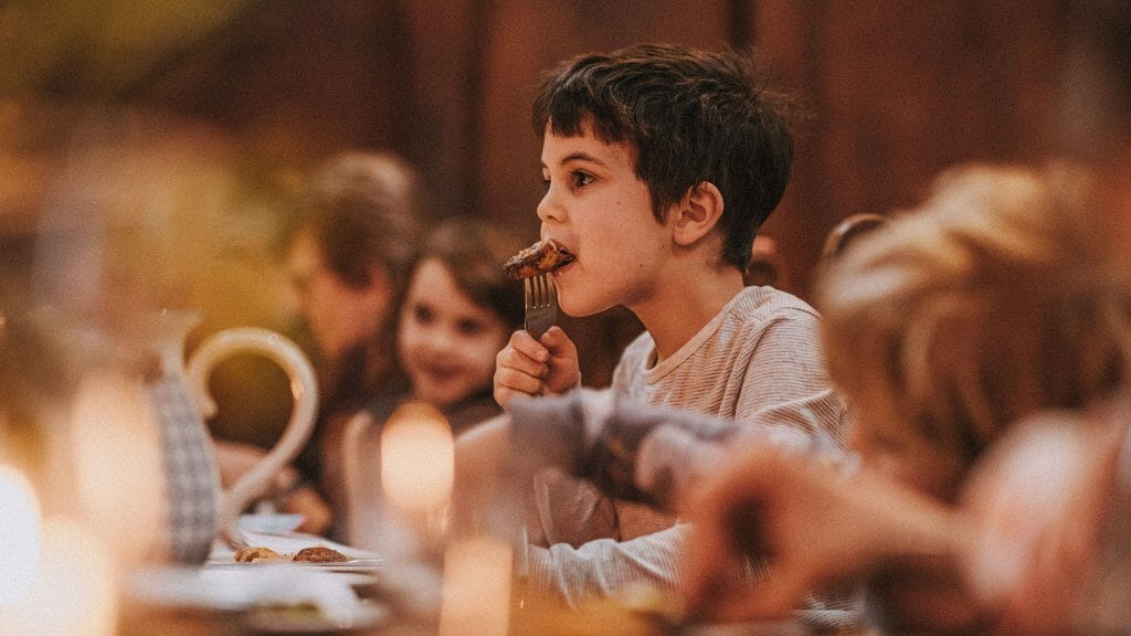 Boy enjoying lunch at the white hart