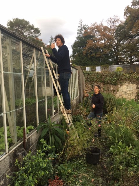 Olivier helps repair the Walled Garden greenhouse