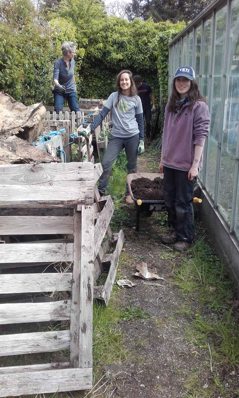 students from Schumacher College sort the compost
