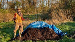 Gardener examining the compost